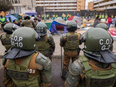 Policía de Chile investiga quema de pertenencias de migrantes